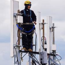 Man working on mobile mast
